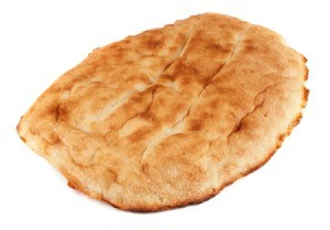 Single piece of flat bread against a white background