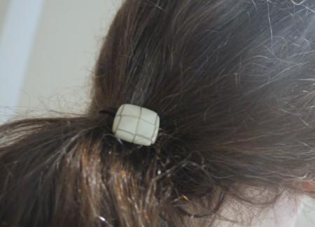 button hair tie in hair