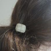 button hair tie in hair