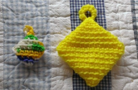 two small crochet hot pad magnets
