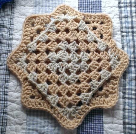 Finished crocheted coaster.