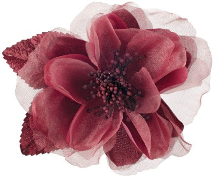 A single maroon fabric flower against a white background