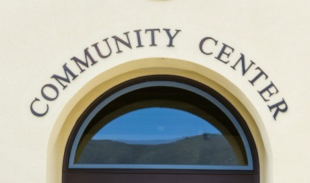 "Arched window on a building with the words ""Community Center"""