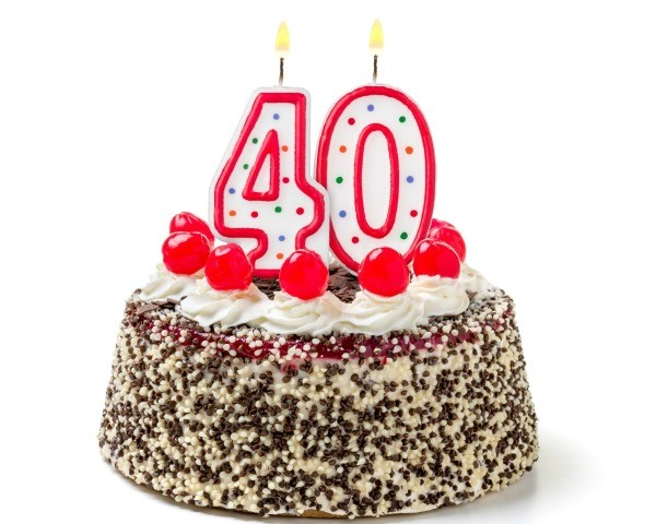 Burning Candles Shaped Like The Number 40 On A Cake Against White Background Womans 40th Birthday