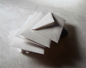 Sepia tint image of a stack of white envelopes