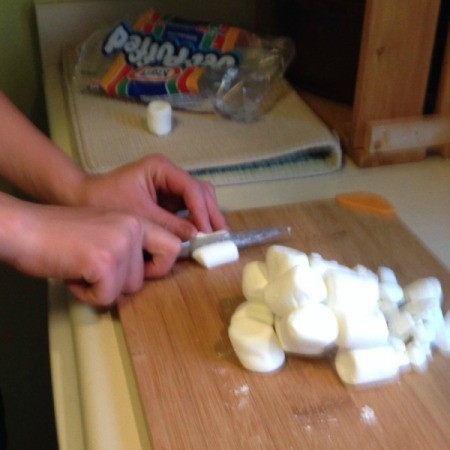 Chopping marshmallows.