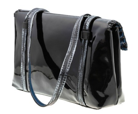 Black patent leather purse against a white background