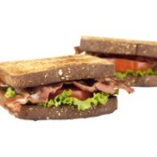 Two BLTs (Bacon Lettuce Tomato Sandwiches) against a white background