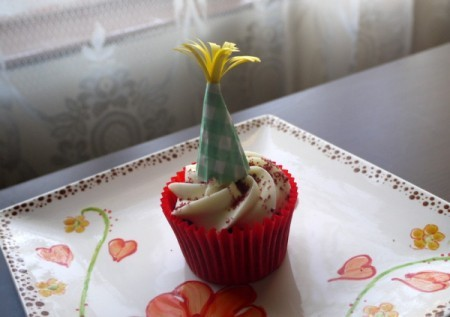 cupcake topped with paper party hat decoration