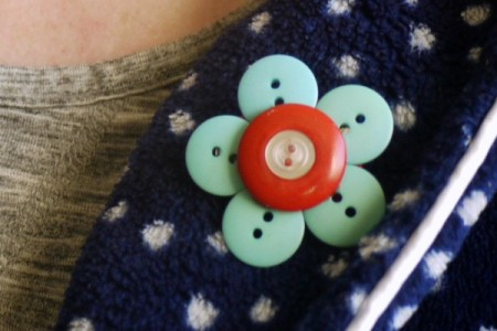 button brooch on collar