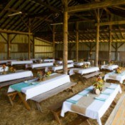 A barn decorated for a wedding reception.