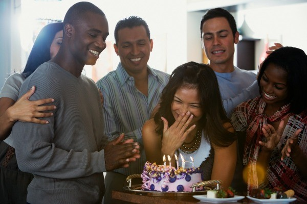 Surprised Woman And A Group Of Friends With Cake Planning Surprise Birthday Party