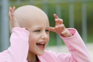 Young bald girl smiling