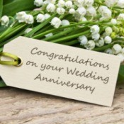 """Bouquet of Lily of the Valley with a card reading """"Congratulations on your Wedding Anniversary"""""""