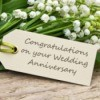 "Bouquet of Lily of the Valley with a card reading ""Congratulations on your Wedding Anniversary"""
