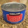 Tin of canned chicken on a granite countertop