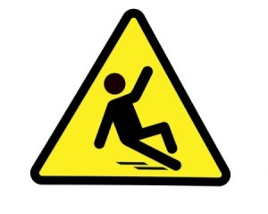 Warning sign showing a stick figure slipping