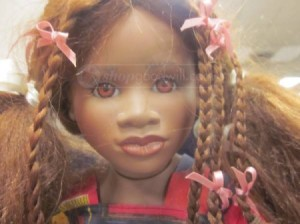 brown skinned doll with braids