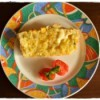 A slice of corn and sweet basil savory bread.