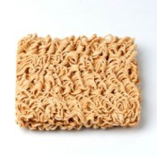 Rectangle of dry ramen noodles on a white background
