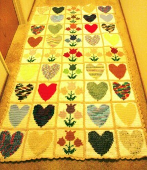 rectangular finished crochet project made of up hearts and tulip blocks