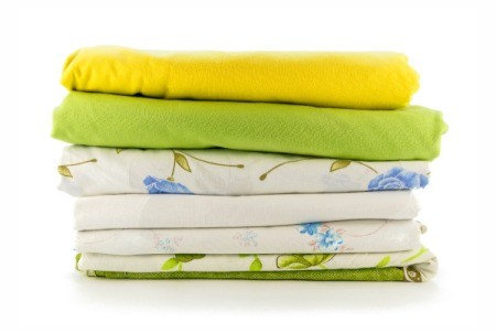 Stack of folded old bed sheets