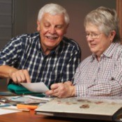 Senior couple working on a scrapbook together