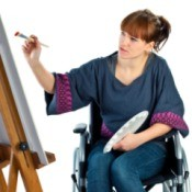 Woman in wheelchair painting