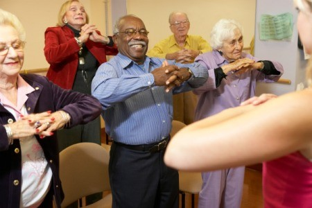 Seniors participating in a stretching class