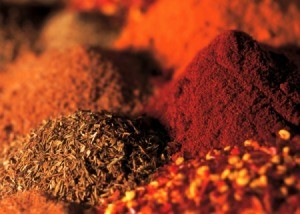 Close up image of piles of several different spices