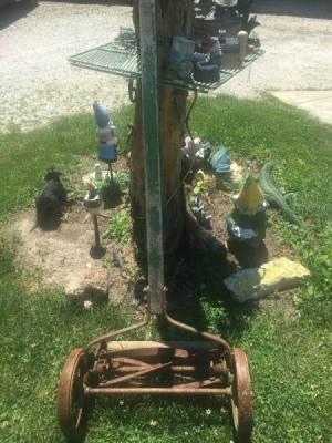 old reel mower in yard