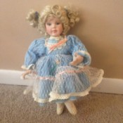 blond haired doll in blue dress
