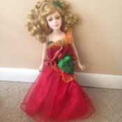 doll wearing a red evening gown