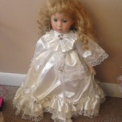 child doll in white satin dress
