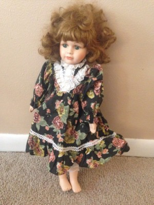 doll wearing a floral dress