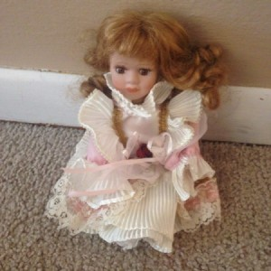doll in pink dress with pleated ruffles