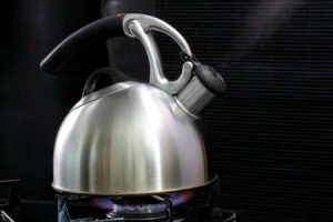 Steaming Tea Kettle on black
