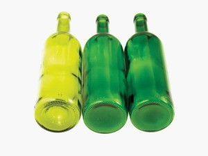 Three empty green wine bottles against white background