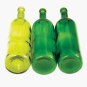 Three empty green wine bottles against white background