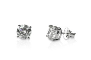 A pair of diamond stud earrings isolated against a white background