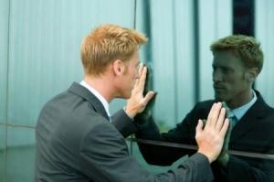 Man looking intently at reflective wall