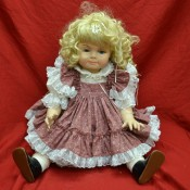 blonde doll in pink flowered and white dress