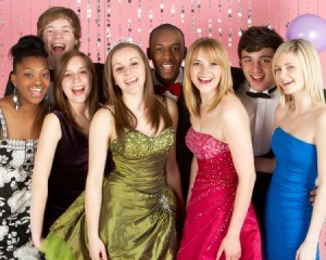 Group of teen boys and girls dressed for prom