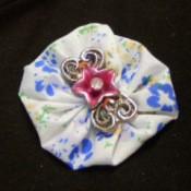 fabric yo yo brooch with decorative flower