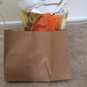 Two shopping bags with items inside.