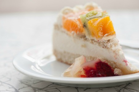 Slice of Ssaeng Cream Cake (Korean style sponge cake with whipped cream frosting and fruit)