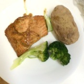 Baked Salmon with Marinade on a plate with a baked potato and broccoli