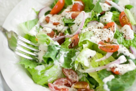 Salad with Ranch Dressing drizzled over it
