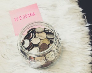 Jar with coins labelled Wedding