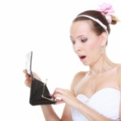 Bride looking at empty wallet in shock